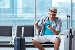 The young man travelling for his summer beach vacation. Young man travelling for his summer beach vacation Stock Image
