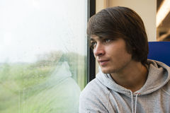 Young Man Travelling In Train Stock Image
