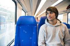 Young Man Travelling In Train Royalty Free Stock Images