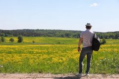 Young man travels with a backpack. On a summer day outdoorsr Royalty Free Stock Photography
