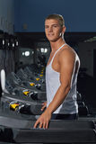 Young man on a treadmill Royalty Free Stock Photos