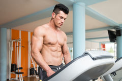 Young Man On Treadmill Stock Photo