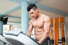 Young Man On Treadmill Royalty Free Stock Images