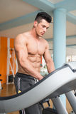 Young Man On Treadmill Stock Images