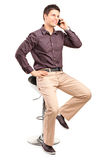 Young man in trendy clothes talking on the phone Royalty Free Stock Images