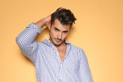 Young man with trendy hairstyle posing royalty free stock photos