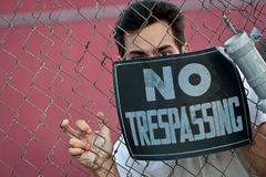 Young Man Trespassing Stock Photo