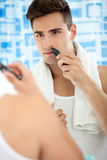 Young man with trimmer Stock Photography