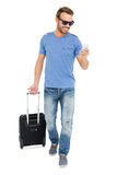 Young man with trolley bag and mobile phone Stock Photography