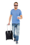 Young man with trolley bag and mobile phone Royalty Free Stock Photography