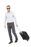 Young man with trolley bag Royalty Free Stock Photo
