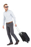 Young man with trolley bag Stock Images