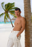 Young man on a tropical beach Stock Photography