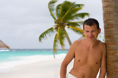 Young man on a tropical beach Stock Photo