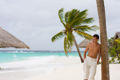 Young man on a tropical beach Royalty Free Stock Photography