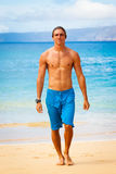 Young Man on Tropical Beach Stock Image