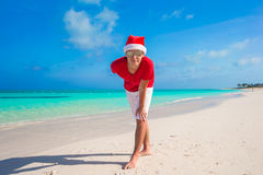 Young man on tropical beach in Christmas Hat Royalty Free Stock Images