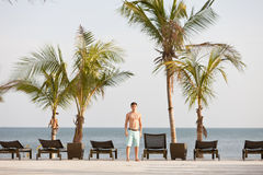 Young man in tropical resort at the Pacific Ocean stock images