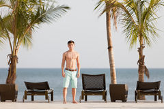 Young man in tropical resort at the Pacific Ocean Stock Photo