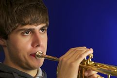 Young Man with Trunpet. Handsom young man Playing trumpet Royalty Free Stock Images