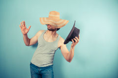 Young man trying on hats Stock Photography