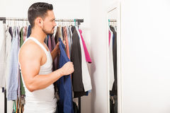 Young man trying on a shirt Stock Photos