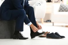 Young man trying on shoes. In shop Stock Image