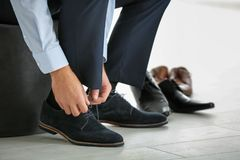 Young man trying on shoes. In shop Royalty Free Stock Photo