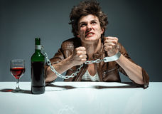 Young man is trying to break the chains Royalty Free Stock Image
