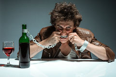Young man is trying to gnaw the chains Royalty Free Stock Images