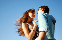 Young man trying to kiss girl Royalty Free Stock Images