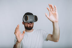 Young man trying vr goggles. Isolated on white background Stock Image