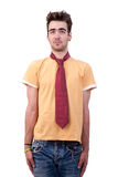Young man with a tshirt and a tie, making a funny Royalty Free Stock Photo