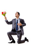 Young man with tulips Stock Photos