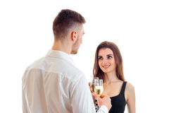 The young man turned to a beautiful girl and drinking wine with her close-up Royalty Free Stock Photography