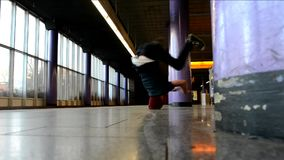 Young man is turning his head in the Prague subway stock video footage