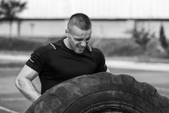 Young Man Turning Tires Outdoor Stock Images
