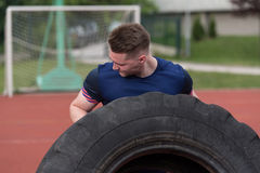 Young Man Turning Tires Outdoor Royalty Free Stock Photography