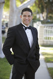 Young Man In Tuxedo Standing With Hands In Pocket At Quinceanera Royalty Free Stock Photo