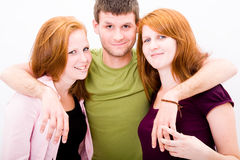 A young man and two beautiful girl Stock Photo
