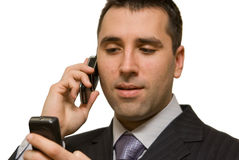 Young man with two cellphones Double calling stock images