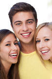 Young man with two female friends royalty free stock photos