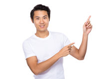 Young man with two finger pointing up Stock Photo
