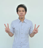 Young man two fingers Stock Photo