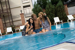 Young man and two girls stock images
