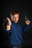 Young man with two guns Stock Image