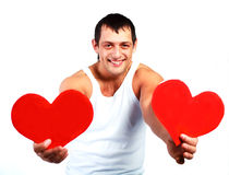 Young man with two hearts Royalty Free Stock Photo