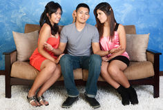 Young Man with Two Ladies Royalty Free Stock Photography