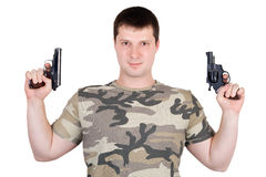 Young man with a two pistol Royalty Free Stock Photos