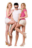 Young man and two playful girls Stock Photography